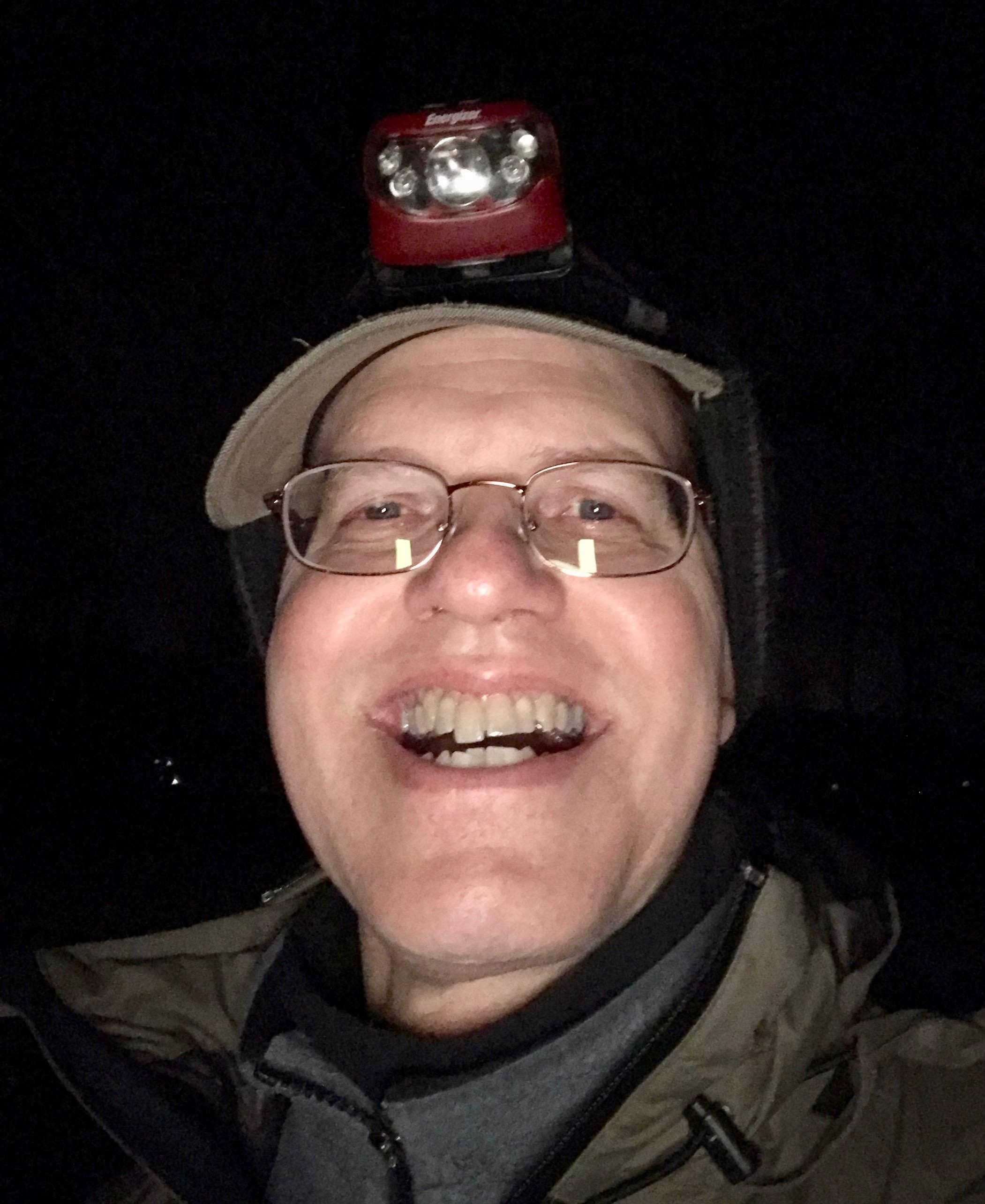 Flashlight hat man